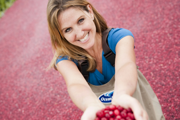 Adrienne Moller Holding Cranberries